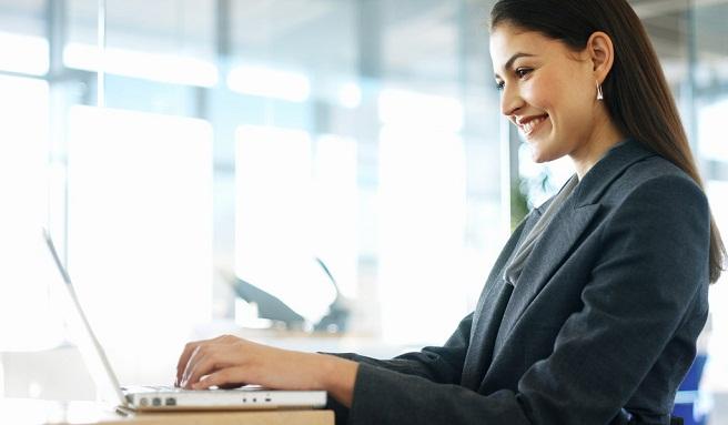 Businesswoman Sitting in a Wheelchair Working on Her Laptop