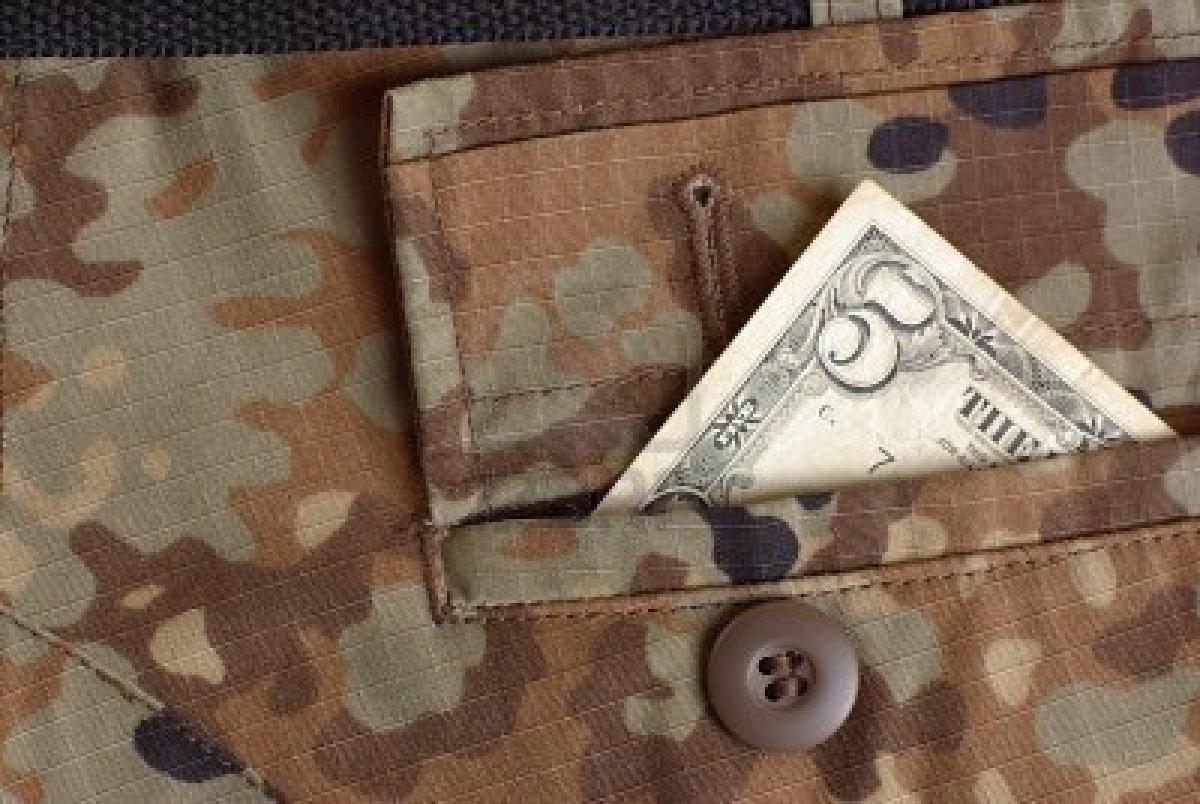 6858857-guerra-y-dinero