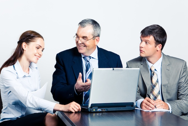 Communication of elderly boss with his managers